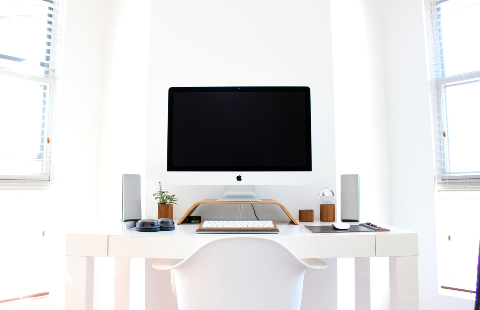 Computer desk with muted speakers