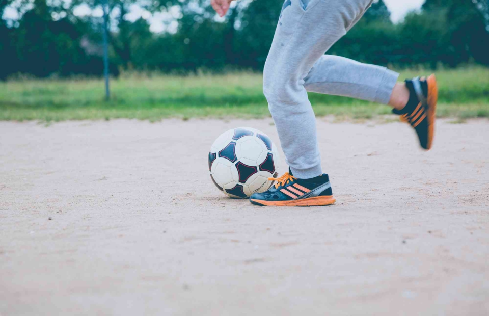 Child kicking a soccer ball