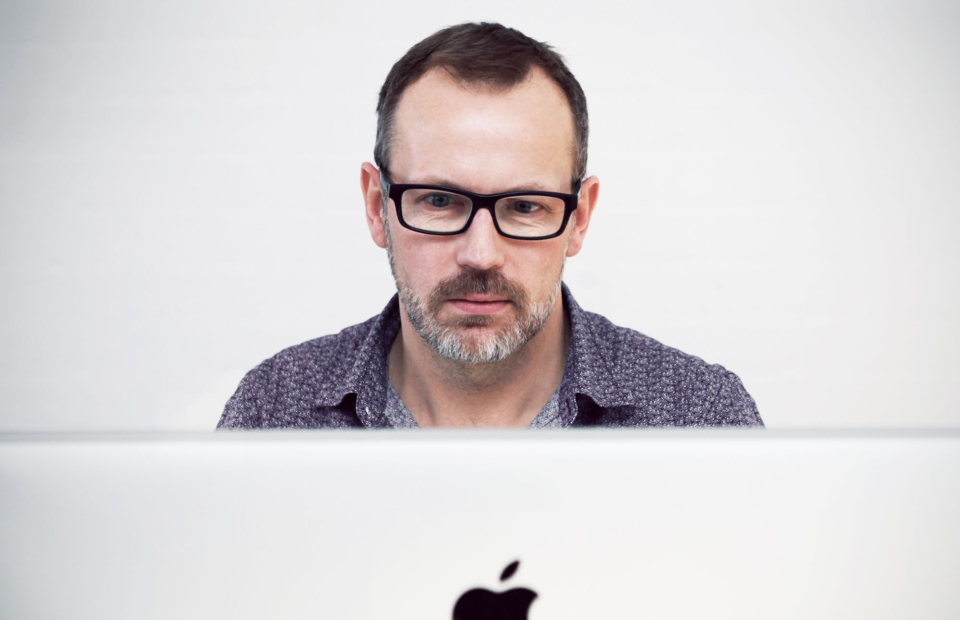 Man looking at website on computer