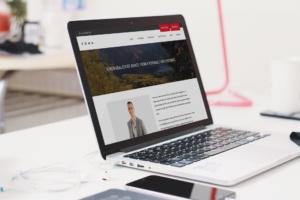Mark's website on laptop