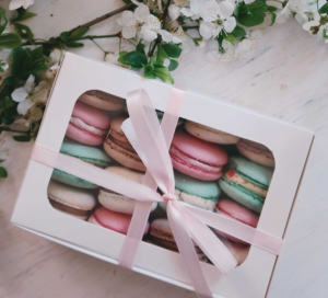 A box of macarons with consistent branding packaging