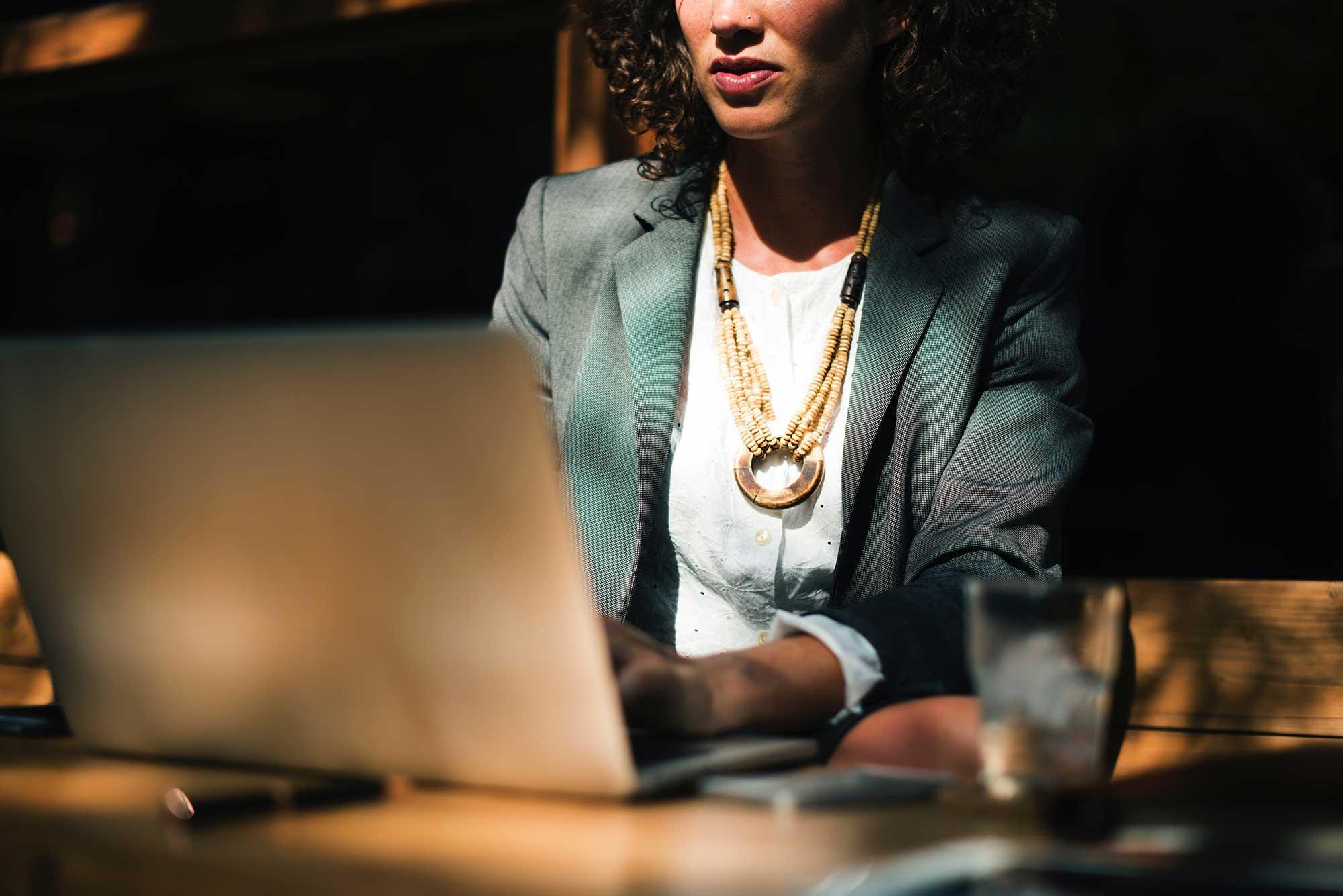 Woman editing website on laptop